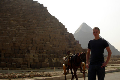 Rob at the base of the Pyramid of Khufu with the Pyramid of Khafre rising in the background - Giza, Egypt ... November 20, 2006 ... Photo by Emily COnger
