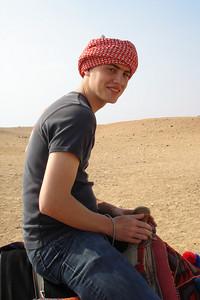Rob, riding his camel arab style - Giza, Egypt ... November 20, 2006 ... Photo by Emily Conger