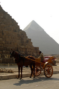 At the base of the Pyramid of Khufu with the Pyramid of Khafre in the background - Giza, Egypt ... November 20, 2006 ... Photo by Rob Page III