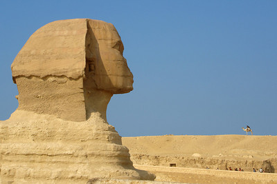 The Sphinx with a man on a camel in the background - Giza, Egypt ... November 20, 2006 ... Photo by Rob Page III