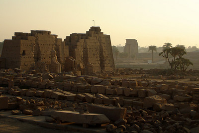 Across the rubble of ancient statues and columns.  One of the pylons, the Eighth I believe, rises on the north-south axis of Karnak - Luxor, Egypt ... November 24, 2006 ... Photo by Rob Page III