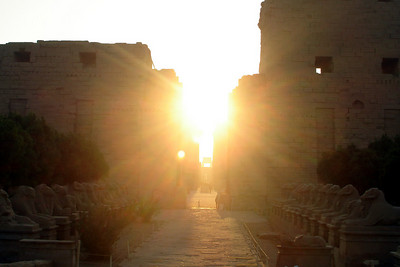 Looking down the east-west axis of Karnak at sunrise.  This is near the Precinct of Amun-Re - Luxor, Egypt ... November 24, 2006 ... Photo by Rob Page III