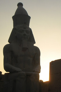 The sun sets behind Ramesses II at Luxor Temple - Luxor, Egypt ... November 24, 2006 ... Photo by Rob Page III