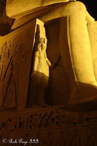 A mini statue on a big statue - Luxor, Egypt ... November 24, 2006 ... Photo by Rob Page III