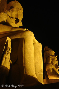 The mini statue is dwarfed by the giant Ramesses - Luxor, Egypt ... November 24, 2006 ... Photo by Rob Page III