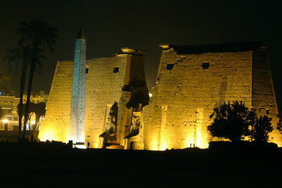 The Luxor Temple guarded by Ramesses and a granite obelisk - Luxor, Egypt ... November 23, 2006 ... Photo by Rob Page III