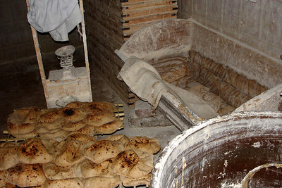 Making one of the staples of the Egyptian diet.  In this room they weigh the dough so each piece is the same weight. - Cairo, Egypt ... November 21, 2006 ... Photo by Rob Page III