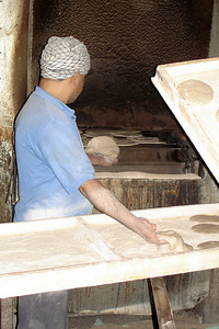 Putting the bread into the giant oven - Cairo, Egypt ... November 21, 2006 ... Photo by Rob Page III