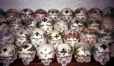 Space is at a premium in Hallstatt, Austria.  After a couple of years the residents dig up the remains, bleach the bones, and then decorate the skulls. ... June 30, 2001 ... Photo by Rob Page III