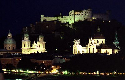 Salzburg, Austria. The city bei Nacht (by night). The churches, from the left, are Dom (both the large cupola and the two-tower facade just to the right of it), University, and St. Peter in the back unlit. ... June 30, 2001 ... Photo by Rob Page III
