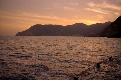 Sunset from Vernazza looking northwest towards Monterosso. Cinque Terre, Italy. ... July 10, 2001 ... Photo by Rob Page III