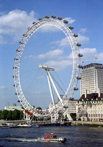 The London Eye, constructed for the millenium is now a beautiful 140 metre ferris wheel overlooking the Thames. ... June 21, 2001 ... Photo by Rob Page III