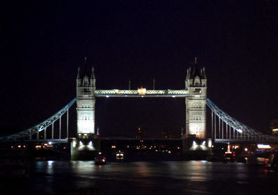 The Tower Bridge illuminating the Thames like it has since 1894. ... June 21, 2001 ... Photo by Rob Page III