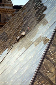 An automated robot that cleans the windows on the glass pyramid above the Louvre entrance. ... June 25, 2001 ... Photo by Rob Page III