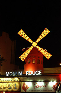 Moulin Rouge.  Immortalized by Toulouse-Lautrec, and the birthplace of the can-can, the Moulin Rouge (The Red Windmill) takes its name from one of the windmills of Montmartre present in another era.  Today is a world famous night spot. ... June 25, 2001 ... Photo by Rob Page III