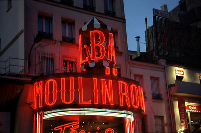 Immortalized by Toulouse-Lautrec, and the birthplace of the can-can, the Moulin Rouge (The Red Windmill) takes its name from one of the windmills of Montmartre present in another era.  Today is a world famous night spot. ... June 25, 2001 ... Photo by Rob Page III