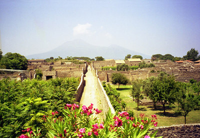 Vesuvius looms over the town - Pompeii, Italy ... July 14, 2001 ... Photo by Rob Page III