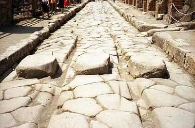 The deep ruts signify that the Romans had standard axle widths and this was a busy town - Pompeii, Italy ... July 14, 2001 ... Photo by Rob Page III