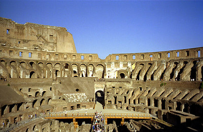 The Colosium.  In ancient times the wooden platform extended all the way across the base of the stadium.  The platform today is a reconstruction - Rome, Italy ... July 13, 2001 ... Photo by Rob Page III
