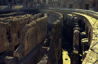 The Colosium.  This is what is left of the labarynth of tunnels and cells where the combatants waited below the stage - Rome, Italy ... July 13, 2001 ... Photo by Rob Page III