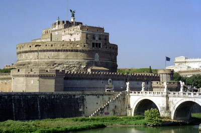 Saint Angelo Castle.  Originally built in the second century as a mausoleum, but over time it came to protect the Vatican City and is connected with underground tunnels.  The river in front is the Tiber River - Rome, Italy ... July 12, 2001 ... Photo by Rob Page III