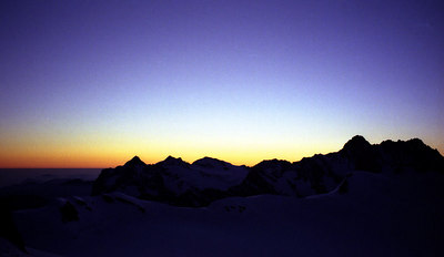 The sunrise from Mönchsjochhutte hut - Switzerland. ... July 3, 2001 ... Photo by Rob Page III