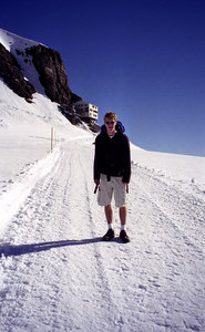 Rob with the Mönchsjochhutte hut in the background - Switzerland. ... July 3, 2001 ... Photo by unknown