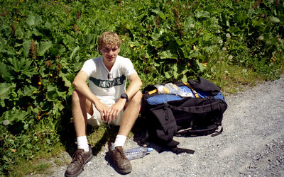 Rob relaxing along the path and having lunch while taking in the Eiger, Monch, and the Jungfrau - Switzerland. ... July 3, 2001 ... Photo by unknown