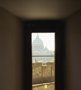 St. Peter's Basillica seen through an archer's slot from Saint Angelo Castle - Rome, Italy ... July 12, 2001 ... Photo by Rob Page III