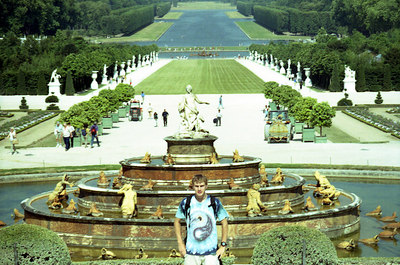Rob and the Parterre d'Eau at Chateau de Versailles with the Bassin d'Apollon and gardens in the background. ... June 26, 2001 ... Photo by unknown.