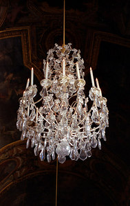 One of the chandeliers in the Hall of Mirrors in Versailles. ... June 26, 2001 ... Photo by Rob Page III