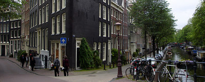 The canals and leaning buildings create interesting angles.  This shot was not done with a wide angle lense. - Amsterdam, Netherlands ... June 15, 2006 ... Photo by Rob Page III