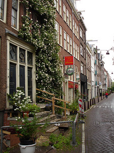 Ducking into a side alley along Vijzelstraat - Amsterdam, Netherlands ... June 15, 2006 ... Photo by Rob Page III