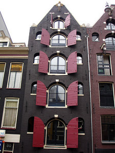 The emblem of the city.  Red shuttered buildings - Amsterdam, Netherlands ... June 15, 2006 ... Photo by Rob Page III