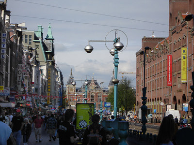 Looking down Damrak back towards Amsterdam Centraal Station.  This is the equivalent of Wall St. in New York.  To the right is the former building for the Amsterdam Stock Exchange.  It is the Beurs van Berlage building - Amsterdam, Netherlands ... June 16, 2006 ... Photo by Rob Page III