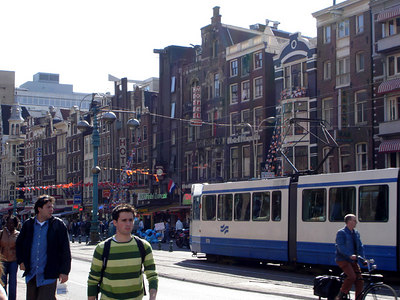 Some of the buildings and streetlife along Damrak - Amsterdam, Netherlands ... June 16, 2006 ... Photo by Rob Page III
