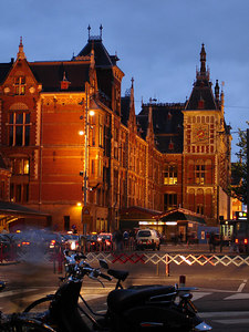 The beautiful Amsterdam Centraal train staton at dusk - Amsterdam, Netherlands ... June 16, 2006 ... Photo by Rob Page III