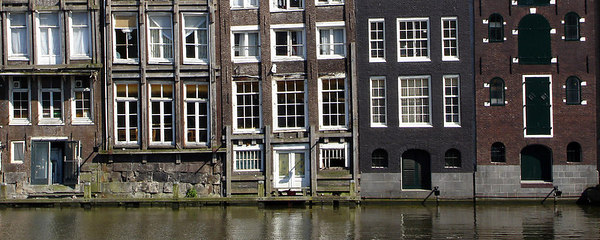 The buildings of Warmoestr with their backs to the Damrak Canal - Amsterdam, Netherlands ... June 16, 2006 ... Photo by Rob Page III