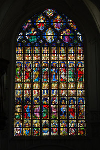 Stain glass inside the 123 m tall Onze-Lieve-Vrouwekathedraal.  The cathedral is a gothic style structure under-consruction since the 14th century  - Antwerpen, Belgium ... June 18, 2006 ... Photo by Rob Page III