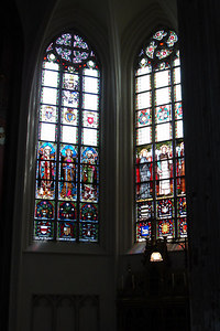 Stain glass inside the 123 m tall Onze-Lieve-Vrouwekathedraal (Cathedral of Our Lady).  The cathedral is a gothic style structure under-consruction since the 14th century  - Antwerpen, Belgium ... June 18, 2006 ... Photo by Rob Page III