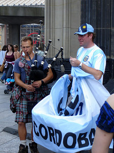 Celebrating the World Cup outside the base of the Cologne Cathedral.  By the way, Scotland didn't even make it, but he made friends with the Argentine fan - Cologne, Germany ... June 14, 2006 ... Photo by Rob Page III