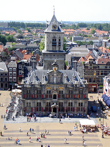 The Stadhuis.  The Delft Town Hall is a remarkable and festive building, both inside and out. Of the original mediaeval building of the Stadhuis or Raadhuis, located on Markt square, which burnt down in 1618, only the squat central tower towards the back now remains. The rest of the edifice was rebuilt around it in 1620 in a festive Northern Renaissance style by architect Hendrick de Keijser (1565-1621) - Delft, Netherlands ... June 17, 2006 ... Photo by Rob Page III