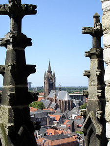 The Oude Kerk with some spires from the Nieuwe Kerk in the foreground - Delft, Netherlands ... June 17, 2006 ... Photo by Rob Page III