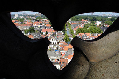 The old town of Delft from the Nieuwe Kerk.  The streets are laced with canals and it is known for its pottery - Delft, Netherlands ... June 17, 2006 ... Photo by Rob Page III