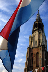 The Nieuwe Kerk with the Netherlands flag waving - Delft, Netherlands ... June 18, 2006 ... Photo by Rob Page III