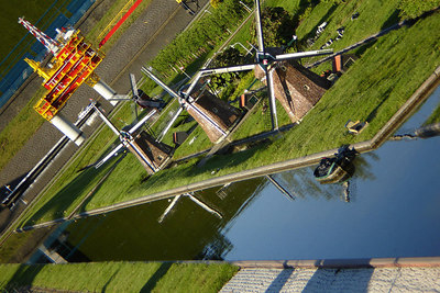 A mock windmill lined canal - Den Haag, Netherlands ... June 17, 2006 ... Photo by Rob Page III