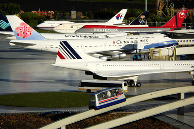 Airplanes at the airport in Madurodam.  This is a city with detailed miniatures of major landmarks in Holland.  It also makes mortals look like GIANTS - Den Haag, Netherlands ... June 17, 2006 ... Photo by Rob Page III