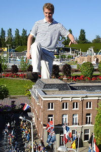 Godzilla Rob at Madurodam.  This is a city with detailed miniatures of major landmarks in Holland.  It also makes mortals look like GIANTS - Den Haag, Netherlands ... June 17, 2006 ... Photo by Emily Conger