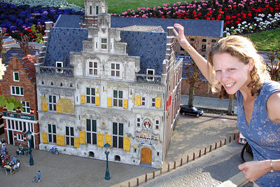 Emily, about to tear down a building at Madurodam.  This is a city with detailed miniatures of major landmarks in Holland.  It also makes mortals look like GIANTS - Den Haag, Netherlands ... June 17, 2006 ... Photo by Rob Page III