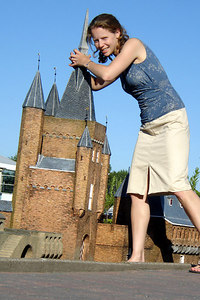 Emily is pulling over one of the castles at Madurodam.  This is a city with detailed miniatures of major landmarks in Holland.  It also makes mortals look like GIANTS - Den Haag, Netherlands ... June 17, 2006 ... Photo by Rob Page III